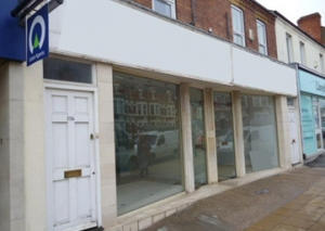 PROMINENT DOUBLE-FRONTED SHOP PREMISES